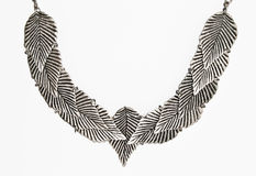 Silver leaf necklace. Necklace with silver leaf on white background Royalty Free Stock Image