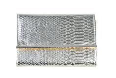 Silver leather clutch on a white background. Silver leather purse on a white background Royalty Free Stock Images