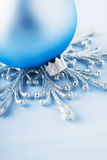 Silver and light blue christmas decoration on wooden background. Royalty Free Stock Image