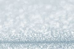 Silver light blue glitter background. Sparkle texture. Abstract gradient background blurred for New Years or Christmas holiday Royalty Free Stock Images