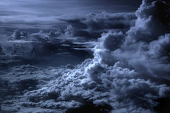 Silver Lining in the Clouds. Flying above large storm clouds Stock Photos