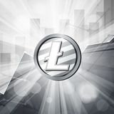 Silver litecoin coin cryptocurrency in bright rays with stat. Silver litecoin coin cryptocurrency in the bright rays with statistics chart Stock Photos