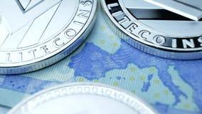 Silver Litecoin Coin on Euro Bills
