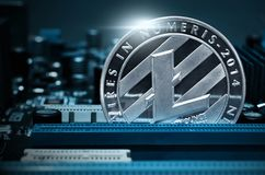 Silver litecoin coin on motherboard. Silver litecoin coins on motherboard royalty free stock photos