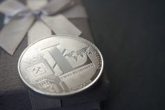 Silver litecoin lying on the euro banknotes stock image