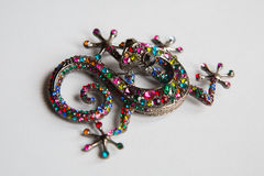 Silver lizard brooch. Decorated with multi-colored stones rhinestones Stock Photography