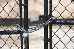 Silver Lock and Chain on Black Gate Stock Photo