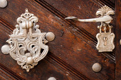 Silver lock on a door. Silver lock on a wooden door Royalty Free Stock Images