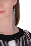 Silver long earring Stock Photo