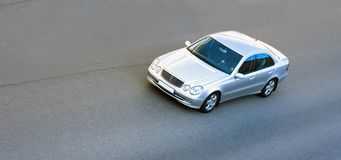 Silver luxury german car speed. Fast on road. any logos removed Royalty Free Stock Image