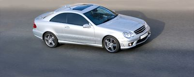 Silver luxury sport coupe car Royalty Free Stock Images
