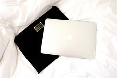 Silver Macbook on Black Case Stock Images