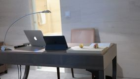 Silver Macbook on Gray Table Stock Photography