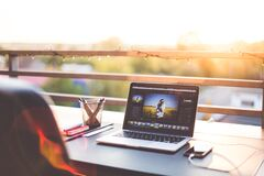 Silver Macbook Pro Beside Black Iphone royalty free stock images