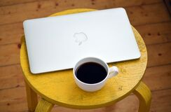 Silver Macbook Beside White Cup Stock Image
