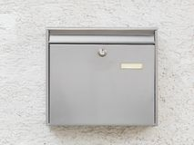 A silver mailbox on the wall Stock Photography