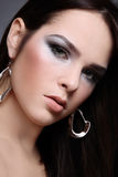 Silver make-up. Close-up portrait of young attractive brunette with stylish silver make-up Stock Images