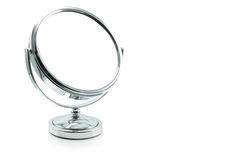 Silver makeup mirror isolated on white. Royalty Free Stock Photography