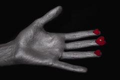 Silver man hand with a heart symbol Royalty Free Stock Photo