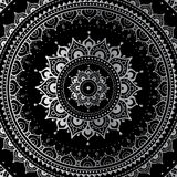 Silver mandala. On black background. Indian pattern Stock Image