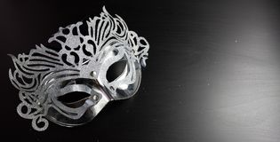 Silver mardi gras mask , Placed on a Black background. Copy space for text. Top view