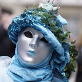 Silver Mask. And blue costume Stock Photos