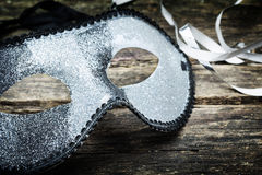 Silver mask on wood Royalty Free Stock Photography