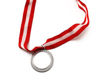 Silver medal. Close up on white background Royalty Free Stock Photography