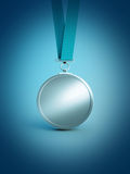 Silver medal award. On blue Royalty Free Stock Image