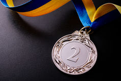 Silver medal on a dark background Stock Photography