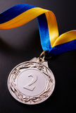 Silver medal on a dark background Royalty Free Stock Image