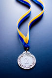 Silver medal on a dark background Royalty Free Stock Photo