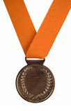 Silver medal on orange ribbon Royalty Free Stock Photos