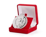 Silver medal in red gift box. Royalty Free Stock Images