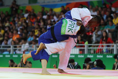 Silver medalist Judoka Audrey Tcheumeo of France in white in action against Sol Kyong of North Korea  during women`s 78 kg match. RIO DE JANEIRO, BRAZIL - AUGUST Royalty Free Stock Images