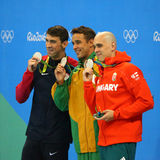 Silver medalists Michael Phelps USA (L), Laszlo Cseh HUN and Chad le Clos RSA during medal ceremony. RIO DE JANEIRO, BRAZIL - AUGUST 12, 2016: Silver medalists royalty free stock image