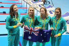 Silver medalists Team Australia Women`s 4 × 100m medley relay at the Rio 2016 Olympics. RIO DE JANEIRO, BRAZIL - AUGUST 13, 2016: Silver medalists Team Stock Image