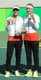 Silver medalists team Switzerland Timea Bacsinszky (L) and Martina Hingis during medal ceremony after doubles final Royalty Free Stock Images