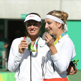 Silver medalists team Switzerland Timea Bacsinszky (L) and Martina Hingis during medal ceremony after doubles final Stock Photo