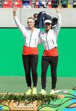 Silver medalists team Switzerland Timea Bacsinszky (L) and Martina Hingis during medal ceremony after doubles final Stock Photography