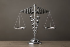 Silver Medical Caduceus Symbol as Scales. 3d Rendering Stock Photos