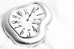Silver melted clock Royalty Free Stock Photo