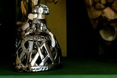Silver menina on green wood shelf royalty free stock photos