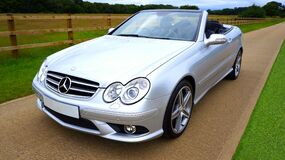 Silver Mercedez Benz Convertible on Brown Concrete Road Stock Photos