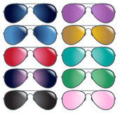 Silver metal aviator sunglasses in colors Royalty Free Stock Photography