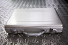 Silver metal briefcase. On a metal background stock images