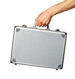 Silver metal briefcase in hand. Isolated on white Stock Photos