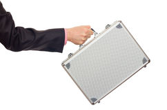 Silver metal briefcase in hand Royalty Free Stock Image