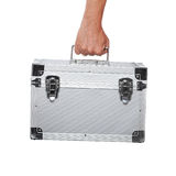 Silver metal briefcase in hand isolated on white Stock Image