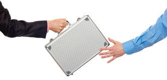 Silver metal briefcase in hands Royalty Free Stock Photos